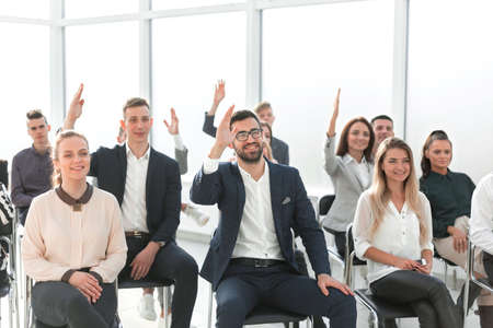 Foto de group of employees asking questions during a business meeting - Imagen libre de derechos