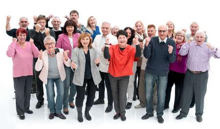 Photo pour Group of senior people raising their hands celebrating a victory - image libre de droit