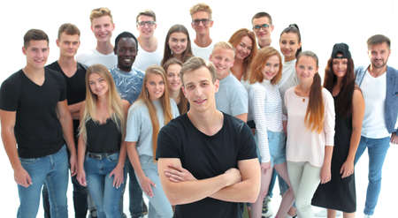 Photo pour confident guy standing in front of a group of young people - image libre de droit