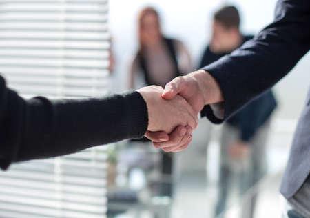 Photo pour Business partnership meeting concept. Image businessmans handshake. Successful businessmen handshaking after good deal. Horizontal, blurred background - image libre de droit