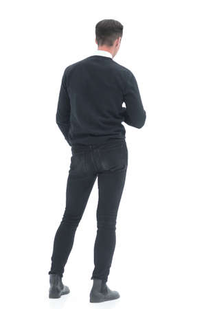 Photo pour rear view. young man standing in front of a white screen - image libre de droit