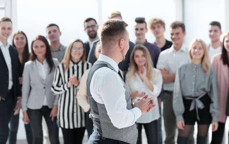 Photo pour young leader looking at a happy business team. - image libre de droit