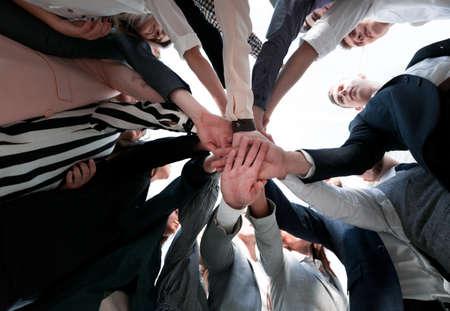 Photo pour close up. happy diverse young people standing in a circle - image libre de droit