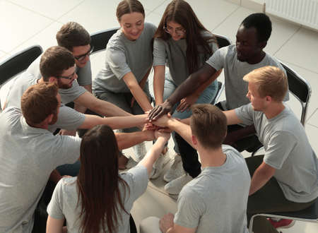 Photo pour young business people making a tower out of their hands - image libre de droit