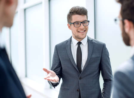Photo for boss talking to employees standing in the office - Royalty Free Image