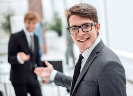 Photo pour close up. friendly businessman inviting to his office - image libre de droit