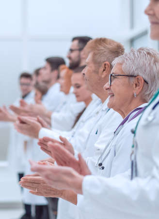 Photo pour large group of medical practitioners applauding together. - image libre de droit