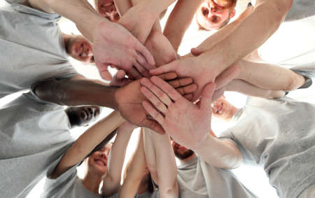 Photo pour group of like-minded people cupping their palms together - image libre de droit