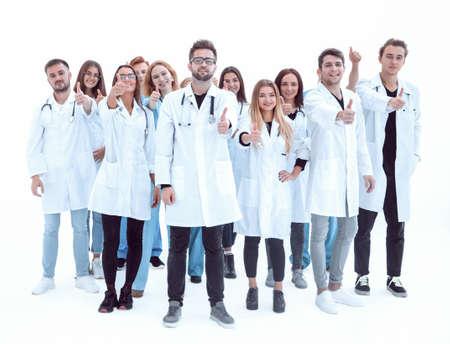 Photo pour large group of diverse doctors giving a thumbs up - image libre de droit