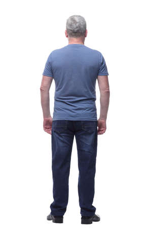 Photo pour Back view of a man in t-shirt and jeans looking away - image libre de droit