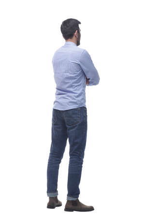 Photo for side view . casual young man reading an ad on a white screen. - Royalty Free Image