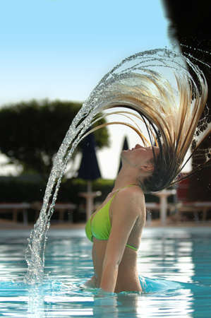 Teenage Model against strong blue with dramatic hair splash