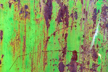 Foto de Detail of green painted, old, metal, rusty doors. Grunge texture of green rusty metal with scratches - Imagen libre de derechos