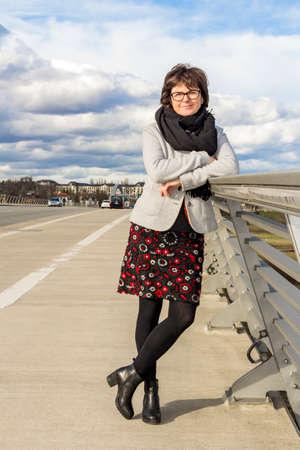 Woman standing on a road bridge