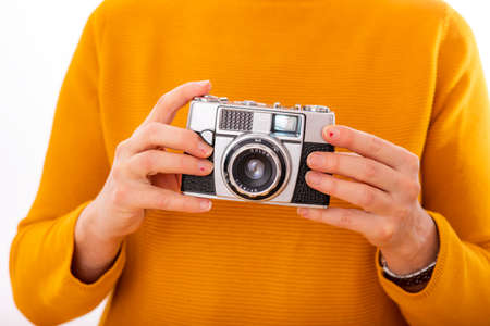 Photo for Woman holds nostalgia camera in her hands - Royalty Free Image