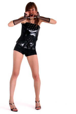 woman in patent leather with handcuff screaming