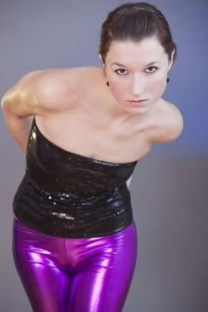 portrait of a woman in shiny leggings
