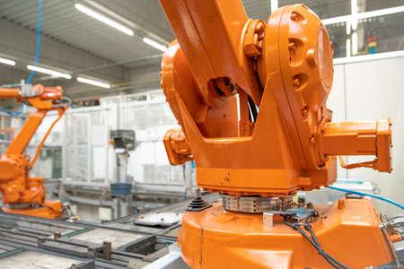 Foto für Detail of a robotic arm in a factory, auto industry - Lizenzfreies Bild