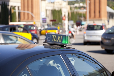 Typical taxi yellow and black in Barcelona, Spain