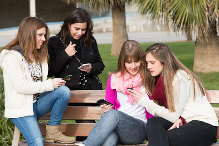Meeting fellow students sending messages to mobile