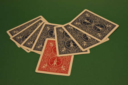 cards on a green rug