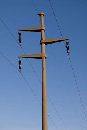 Electrical tower and cables over blue sky