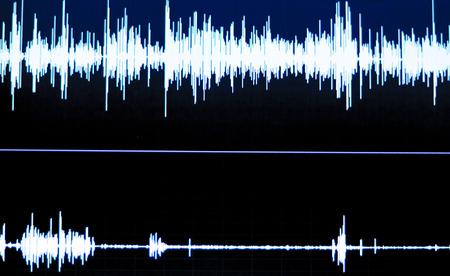 Audio studio digital voice recording voiceover sound wave on computer screen.