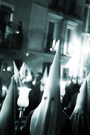 Easter catholic Spanish procession Semana Santa. Catholics wear pointed hoods like KLu Klux Klan.