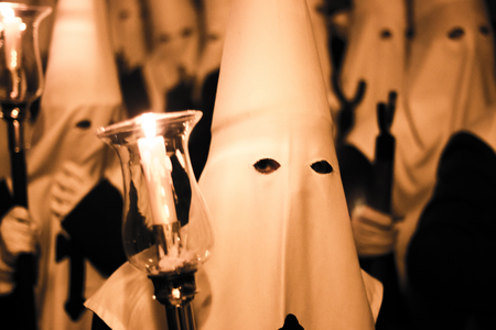 Easter catholic Spanish procession Semana Santa. Catholics wear pointed hoods in Andalusian culture.
