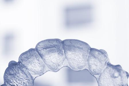 Photo pour Invisible plastic bracket teeth dental aligner orthodontic straighteners. - image libre de droit