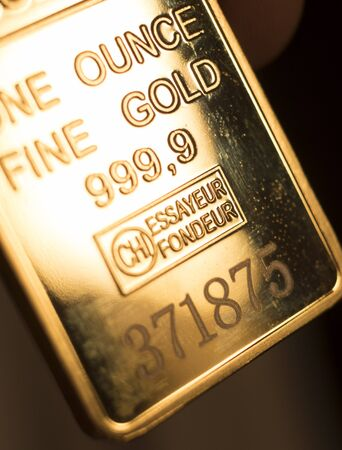 Photo for Fine solid gold 999.9 one ounce bullion ingot precious metals bar closeup isolated photo. - Royalty Free Image