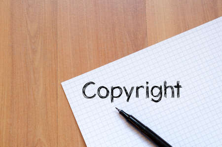 Copyright text concept write on notebook with pen