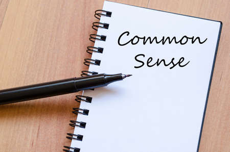 Common sense text concept write on notebook with pen