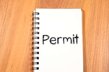 Permit text concept write on notebook