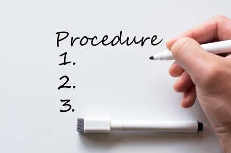 Human hand writing procedure on whiteboard