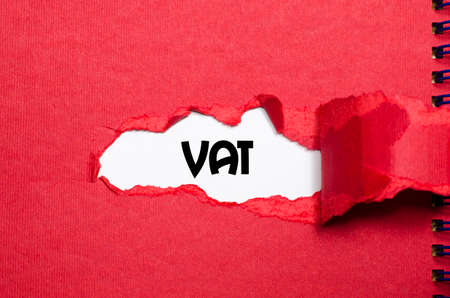 The word vat appearing behind torn paper