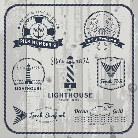 Nautical and seafood labels set with rope frame on gray wood background.