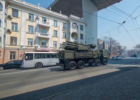 VLADIVOSTOK, RUSSIA - APRIL 13, 2014  Anti-aircraft missile system is driven down Svetlanskaya Street in Vladivostok