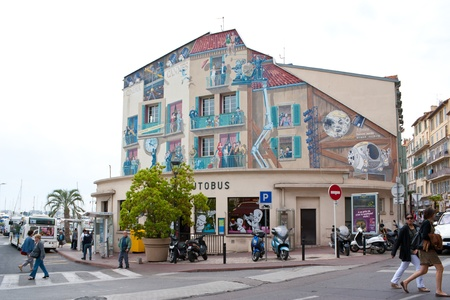 Cannes, France - May 8, 2013: Murals with scenes from famous movies, painted by studio A-Fresco on the frontage of Central bus station of Cannes.