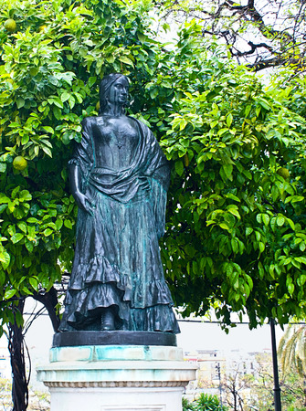 SEVILLE, SPAIN - MAY 3, 2013: The statue to Bizet's Carmen located near the Maestranza Bullring, on May 3 in Seville.