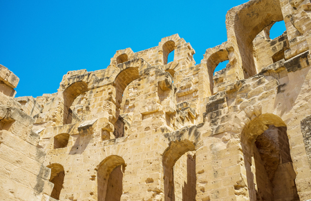 EL JEM, TUNISIA - SEPTEMBER 1, 2015: The walls of the Roman amphitheatre with the numerous arches looks like lace, on September 1, in El Jem.