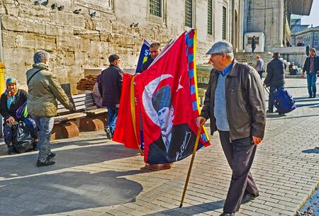 ISTANBUL, TURKEY - JANUARY 21, 2015: The merchant offers souvenir flags with the portrait of Mustafa Kemal Ataturk, on January 21 in Istanbul.