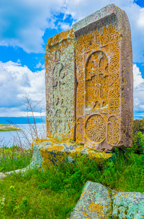 The khachkars are traditional Armenian cross-stones with complex floral, geometric and ethnic patterns, Hayravank, Armenia.