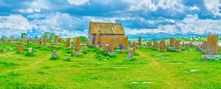 The fast moving clouds over historic  Noratus Cemetery with the tiny Chapel in the middle, Gegharkunik Province, Armenia.