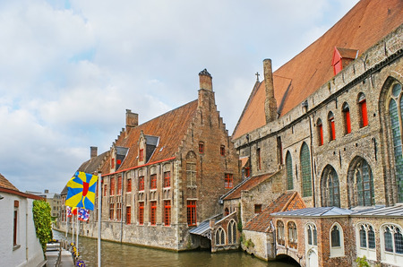 The medieval stepped gables of Saint John's Hospital, one of the oldest hospital buidings in Europe, located at the Groenerei (Green Canal), Bruges, Belgium.