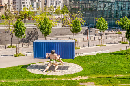 MARSEILLE, FRANCE - MAY 4, 2013: The statue of Sumo wrestlers, lifted blue shipping container in Boulevard de Paris, on May 4 in Marseille.