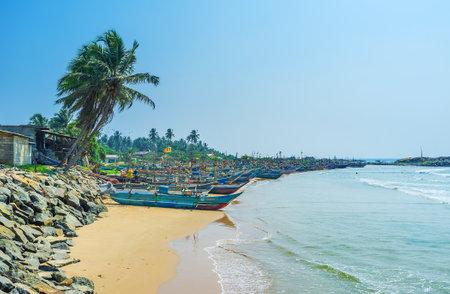 HIKKADUWA, SRI LANKA - DECEMBER 4, 2016: The Kumarakanda fishery harbor is the heart of resort and the famous place among tourists, on December 4 in Hikkaduwa.