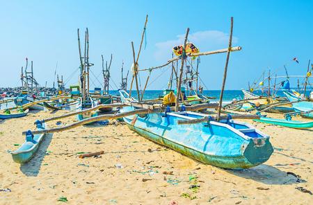 Many resorts of Sri Lankan West Coast offer to visit old fishery harbors with traditional oruwa boats, Kumarakanda harbor, Hikkaduwa.