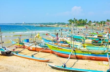 HIKKADUWA, SRI LANKA - DECEMBER 4, 2016: The Kumarakanda harbor with oruwa boats is the interesting tourist site of resort, on December 4 in Hikkaduwa.