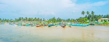 The sand beach of Kumarakanda fisheries harbor is occupied with hundreds of oruwa boats of local fishermen, Hikkaduwa, Sri Lanka.